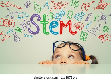 STEM word and symbols over beautiful cute little girl. modern education concept - Shutterstock ID 1161872146