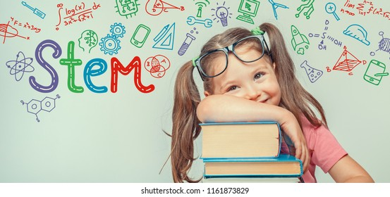 STEM word and symbols over beautiful cute little girl with books. modern education concept