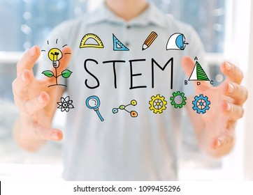 STEM with young man holding his hands - Shutterstock ID 1099455296