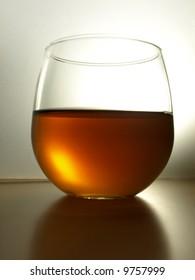 Stemless wine glass, back lit