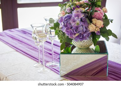 stemware and flowers on the table
