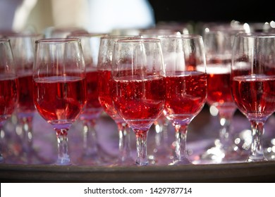 Stemware Glasses Filled with Pink Sparkling Wine Close Up Blurred Background
