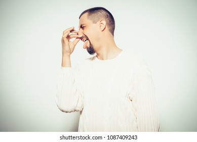 The stench. Closes the man's nose