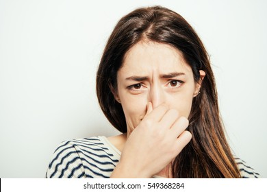 The stench. Closes the woman's nose