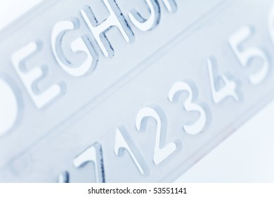 stencil ruler, alphabet, number close up