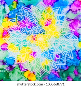 A stenciled mandala over a metallic pearl sublayer with brilliant alcohol ink rainbow design.