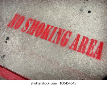 stenciled on ground no smoking area sign