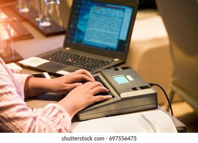The stenographer took shorthand