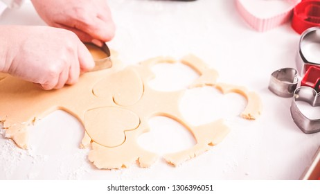 Step by step. Cutting out shapes from sugar cookie dough with cookie cutters.