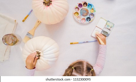 Step by step. Decorating Halloween craft pumpkin with unicorn theme.