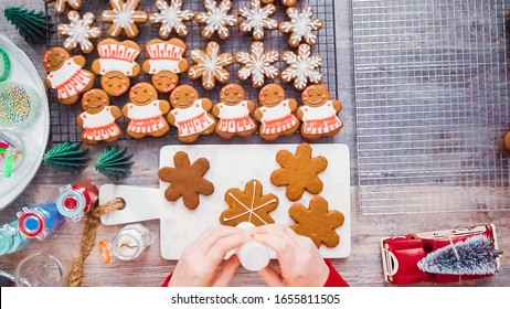 Step by step. Flat lay. Decorating gingerbread cookies with royal icing.