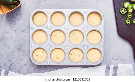 Step by step. Flat lay. Filling metal muffin pan with cornbread batter to bake spicy jalapeno cornbread muffins.