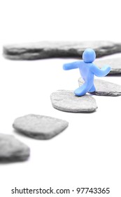 step by step to a higher level - blue plasticine guy jumping over stepping stones - career concept - isolated on white