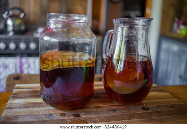 Step by Step how to make Kombucha tea, the brew is ready to be placed in storage with the bacteria culture in place to ferment the brew.