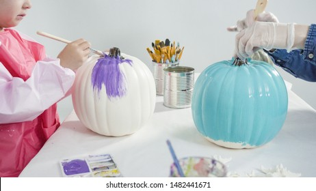 Step by step. Painting craft pumpkin with acrylic paint to create decorated mermaid Halloween pumpkin.