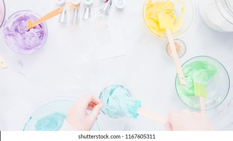 Step by step. Preparing piping bags with colorful buttercream frosting to decorate unicorn theme vanilla cupcakes.