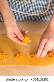 Step by step process of making home-made ravioli or tortelli with pumpkin filling using ravioli stamp. See series