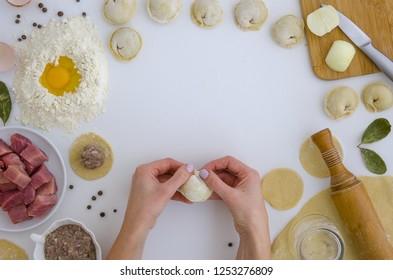 Step by step recipe of homemade pelmeni, dumplings ravioli. Traditionally, woman sculpt makes,mold dumplings in the family. Flat lat frame mockup. hero header pelmeni