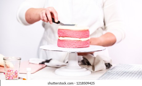 Step by step. Stacking layers together of pink birthday cake.
