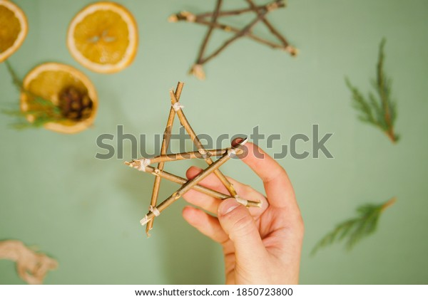 Step by step star make of wooden sticks. Flat lay. Holiday craft guide. Eco friendly decoration