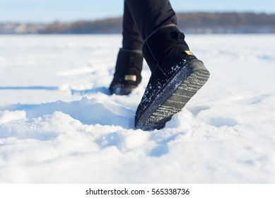 step by UGG  on the snow
