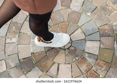 Step in the center of the circle laid out with paving stones