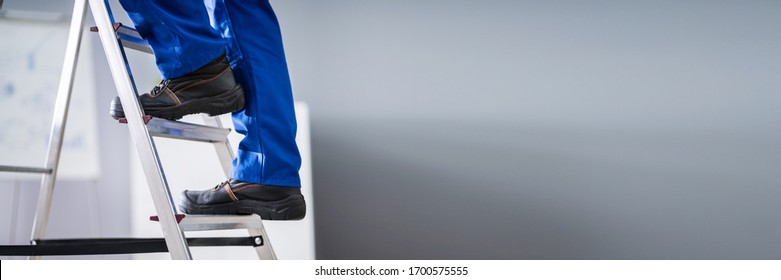 Step Ladder Safety. Worker Man In Shoes