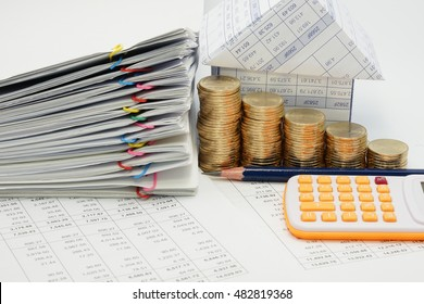Step pile of gold coins and pile overload document with colorful paperclip and house with pencil and calculator on finance account with white background.