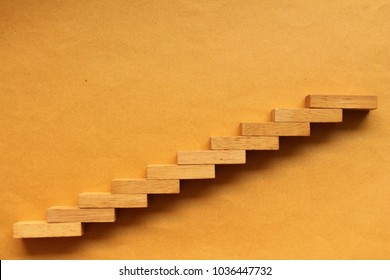 Step stair wood on brown background,Business concept for growth success process.