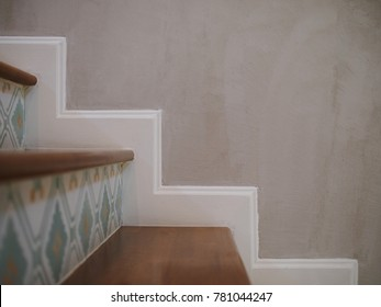 The step up of staircase at hotel with wall background