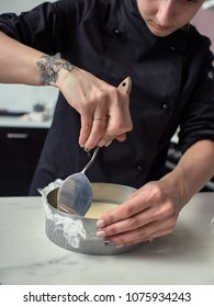 Step-by-step preparation of black designer cake. Cooked cheese cream.