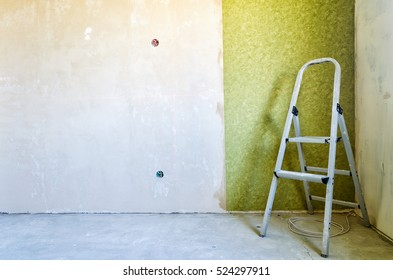 Stepladder standing in the room to renovate