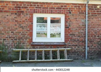 Step-ladder under a window