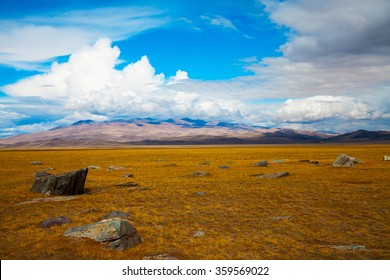 Steppe landscape, blue sky with clouds. Chuya, Kuray steppe in Siberian Altai Mountains. Steppe landscape. Summer steppe. Beautiful landscape. Steppe. Summer landscape. Mountains. Blue sky. Adventure