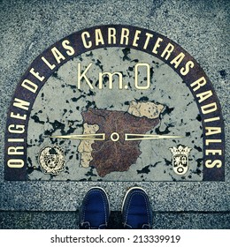 stepped on the Kilometre Zero point in Puerta del Sol, Madrid, Spain, with a retro effect
