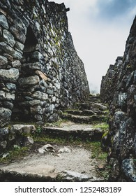A stepped street inside the Inca ruins of Sayamarca on the Inca Trail, Peru, set high within the cloud forest.