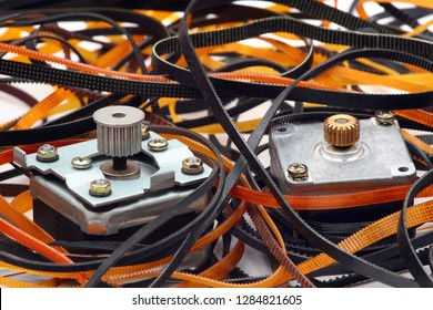 Stepper motors with cogged wheels and cog belts