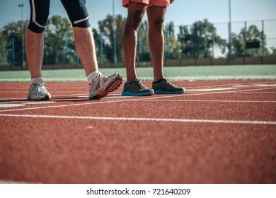 Stepping on the stadium legs of white and black sportsmen
