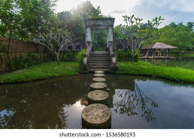 stepping stone in a pond cross the water to beautiful gate. zen garden