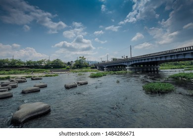 Stepping stones crossing Kamogawa river - main river of Kyoto city