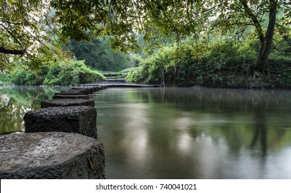 Stepping stones crossing the river Mole at this very popular beauty spot at Boxhill, Dorking, Surrey England.