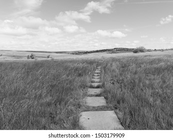 Stepping stones on a hillside cross the Derbyshire countryside near the town of Baslow. Black and white image.