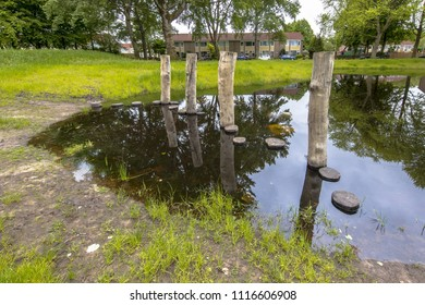 Stepping stones in a pond as part of a playground for children