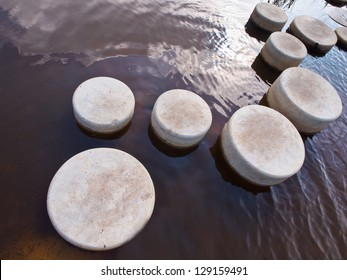 Stepping Stones in Water of a Pond
