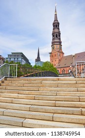 Steps against the beautiful old church in Speicherstadt