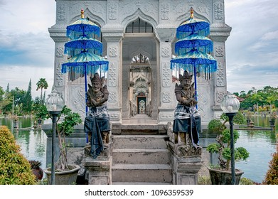Steps to the bridge decorated with hindu sculptures in Taman Ujung park, Bali, Indonesia