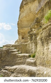 Steps carved into pescenica rocks in the cave city of Chufut-Kale. Crimea, Bakhchisarai