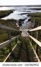 Steps down to salt flats at Burnham Overy Staithe.