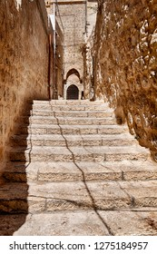 Steps lead toward the back entrance of a building in the Arab Quarter of the Old City of Jerusalem.