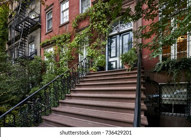 Steps leading up to a colorful brownstone building in an iconic neighborhood of Brooklyn, New York City.